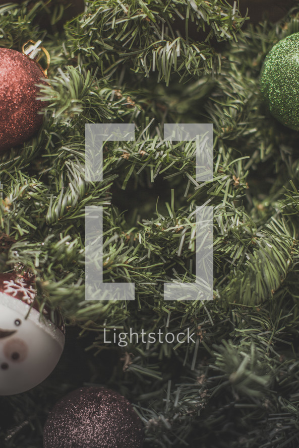 Christmas ornaments on greenery