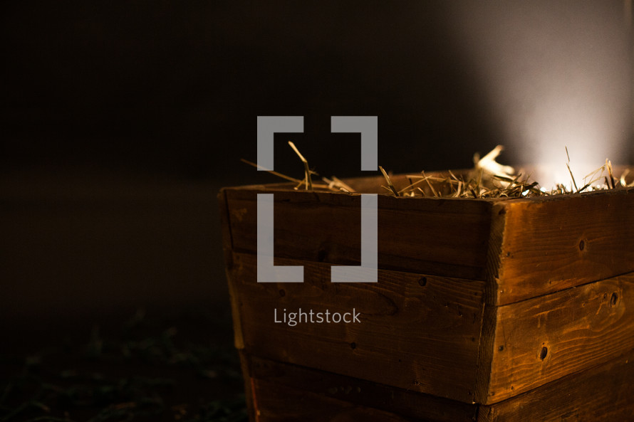 Christmas lights in a glowing manger