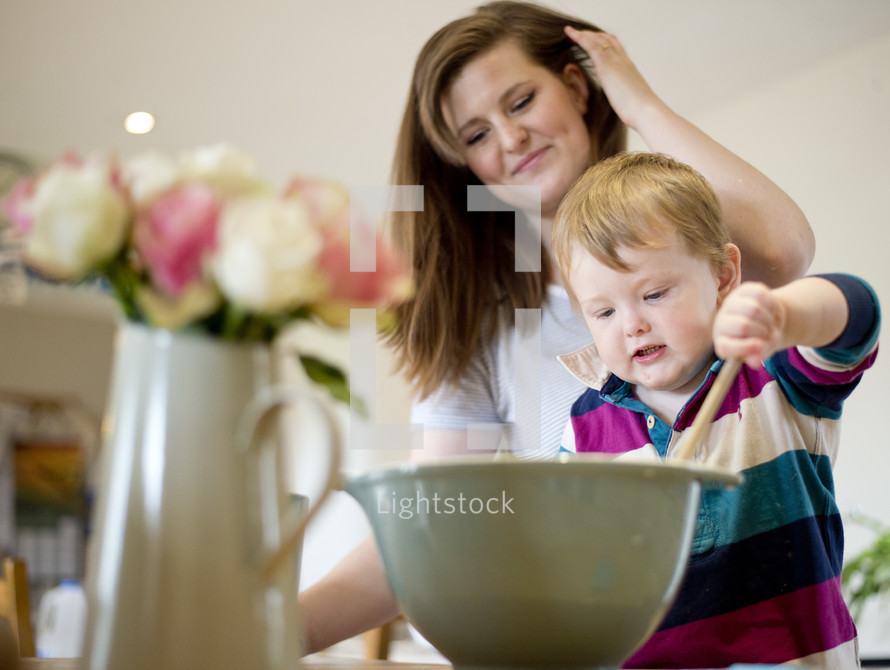 mother and son baking in a kitchen