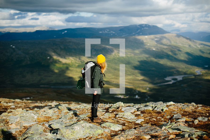 a woman standing on a mountaintop