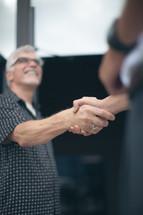 welcoming handshake