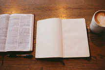 open Bible, journal, and coffee