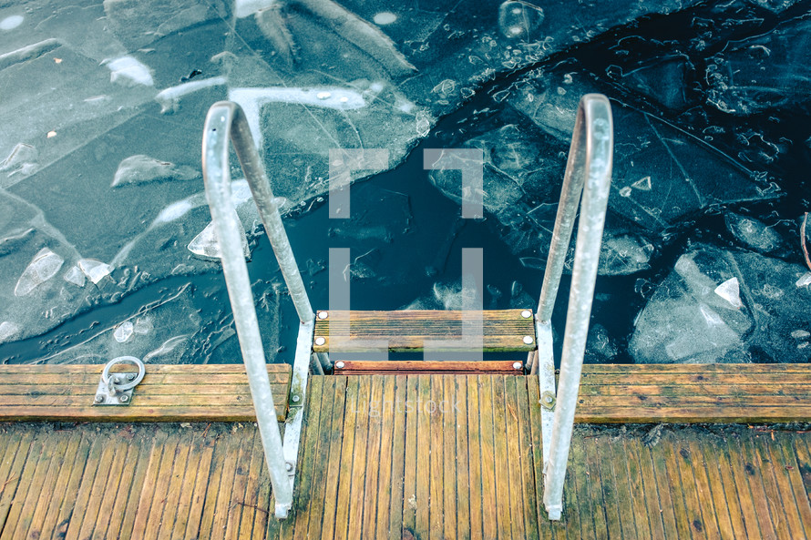 a ladder on dock over a frozen lake