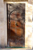 Studded ancient wooden door