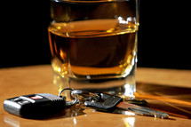 Drinking and Driving – An image of a glass of liquor and car keys symbolize the concept of drinking and driving.