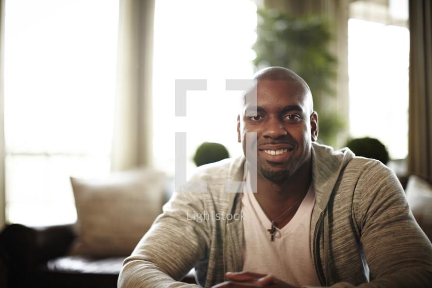 A black man smiling