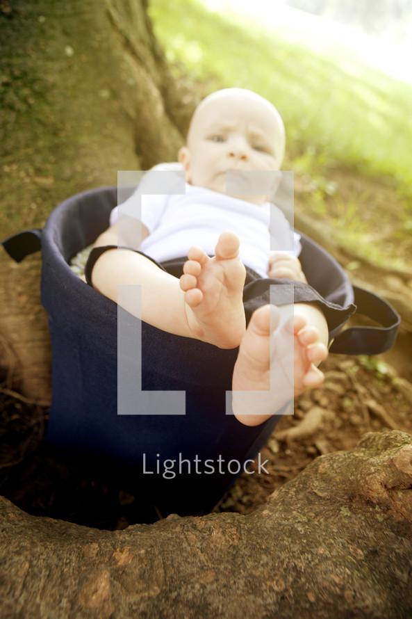 Baby boy in bucket