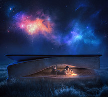 a woman reading in a Bible tent under the stars