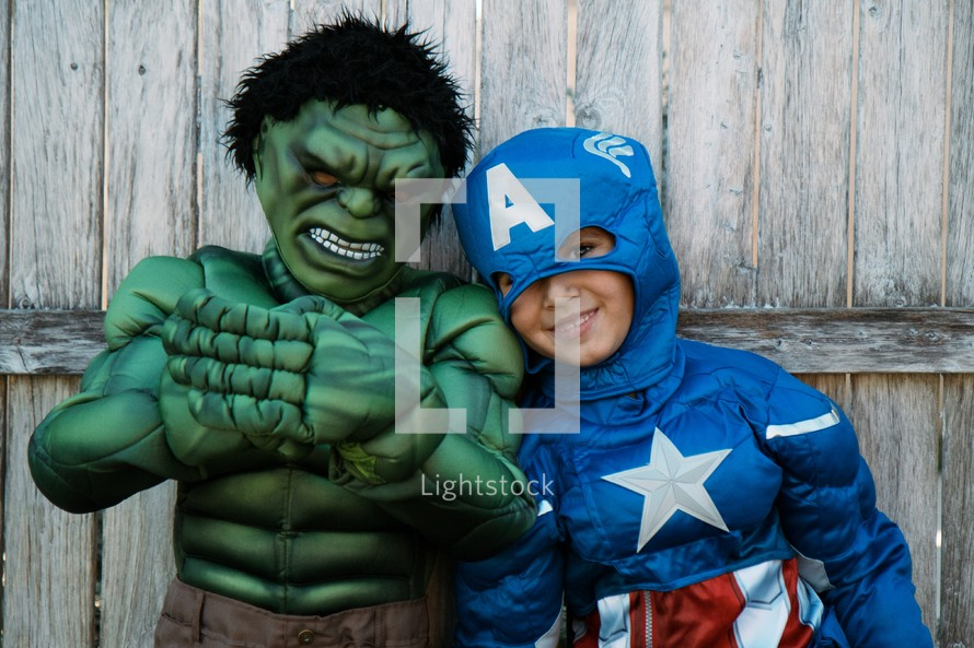 2 kids in costumes