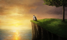 man sitting at the edge of a sea cliff at sunset