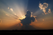 rays of sunshine behind a cloud