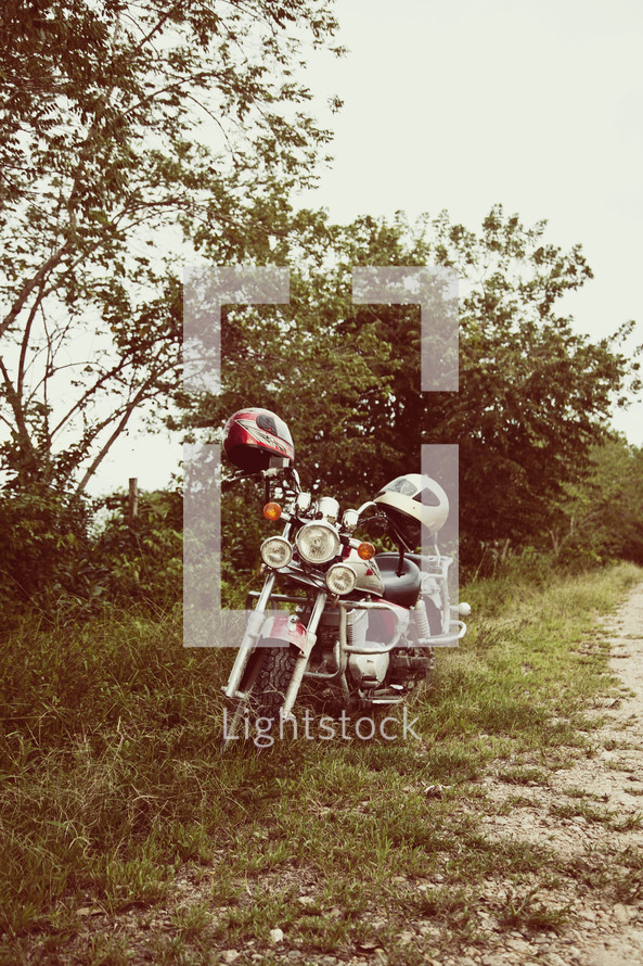 Motorcycle on side of dirt ride