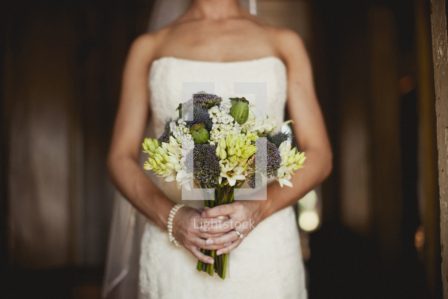 A bride holding a bouquet of flowers