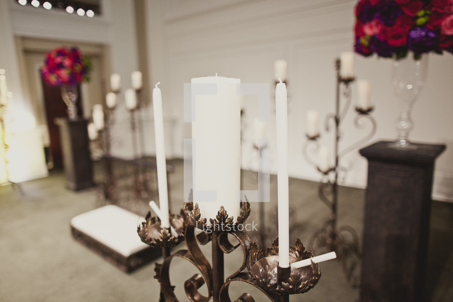 A unity candle at the altar awaits the bride and groom.