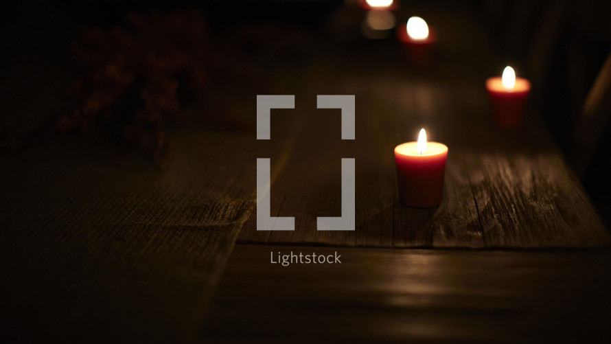 Lit candles on a table