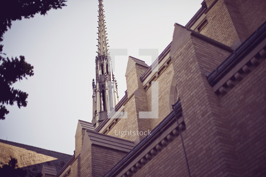 church steeple and side of building against sky - looking up