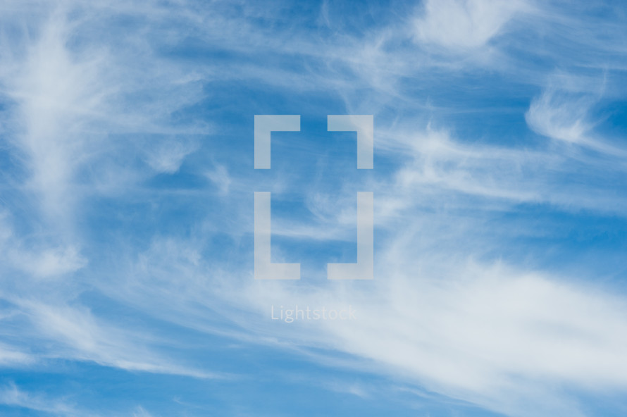 swirling clouds in a blue sky