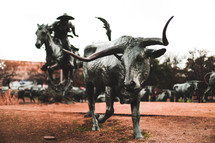 lone horn statue and cowboy