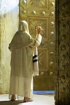 man entering a temple