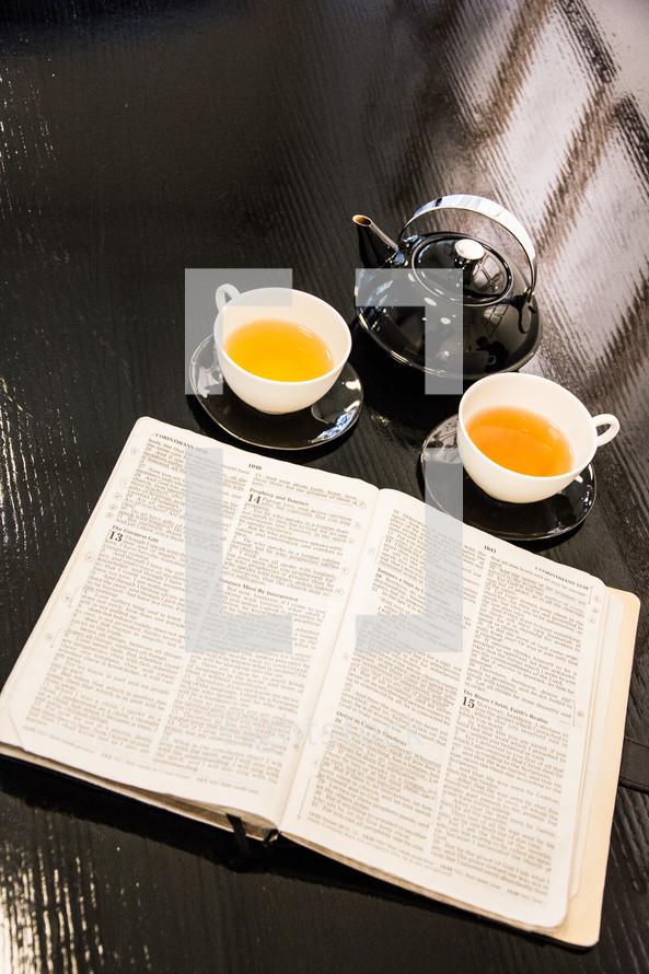 tea and an open Bible