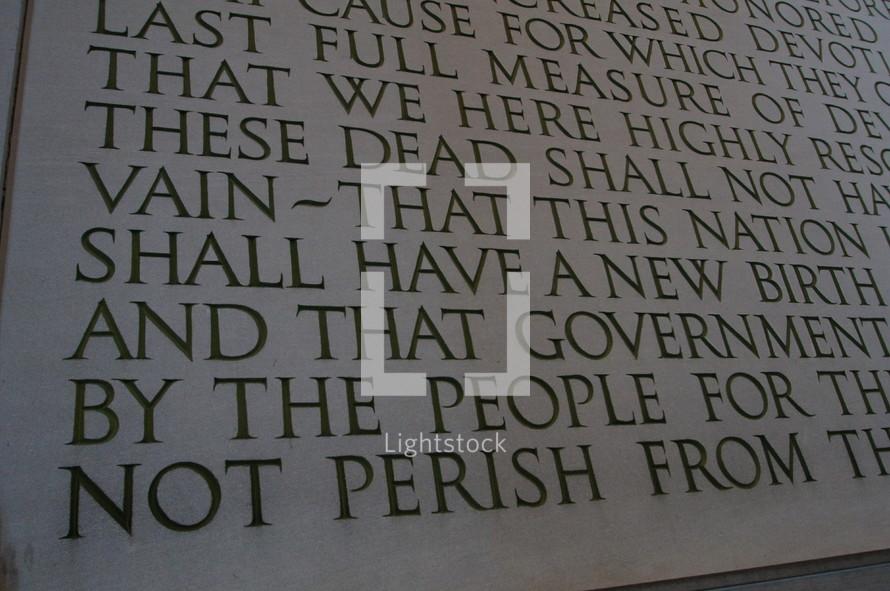 Inscription from a memorial for fallen war veterans.