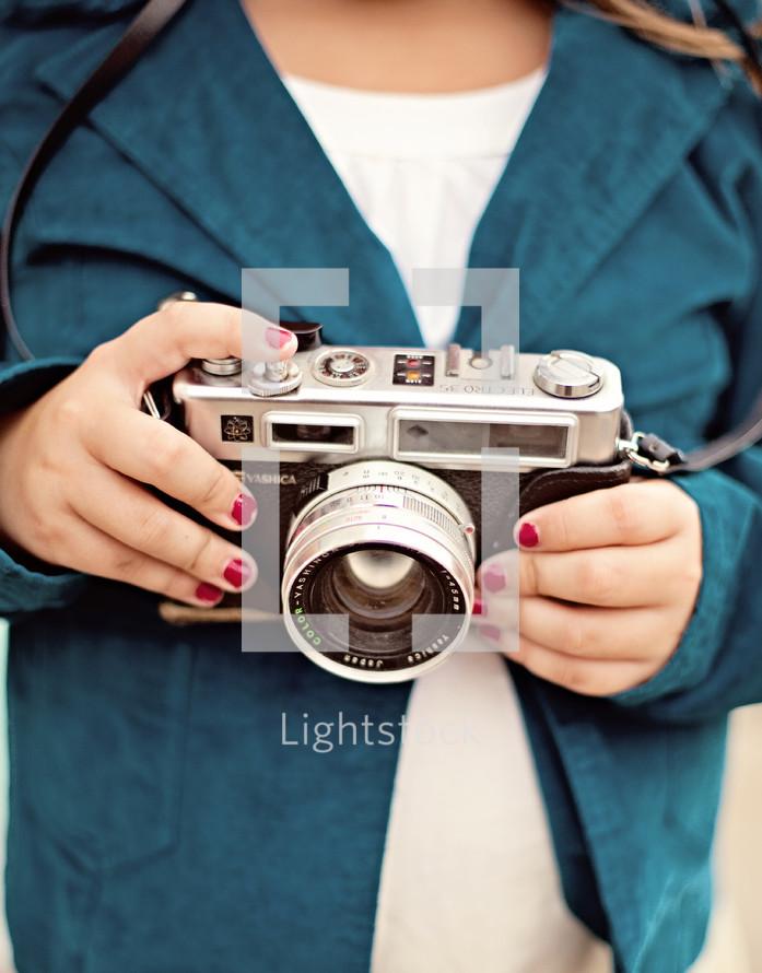 Woman holding vintage camera