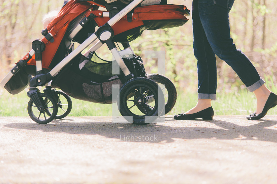 mother pushing a stroller