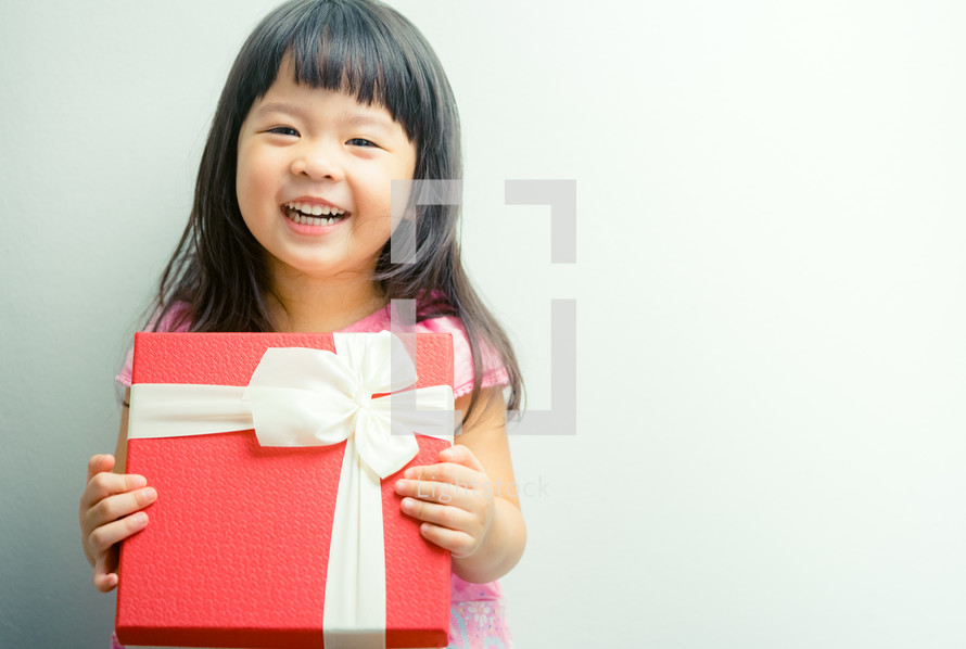 happy girl holding a wrapped gift