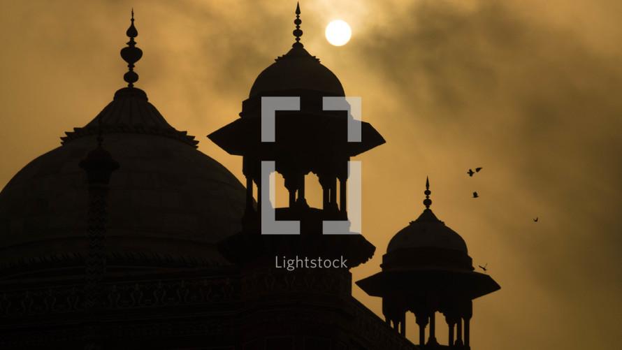 Taj Mahal spire at sunset