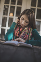 A young woman reading her Bible