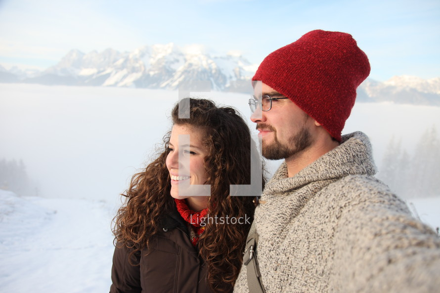 a couple standing in snow
