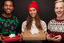 friends holding Christmas gifts