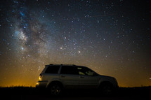 SUV and stars in the night sky