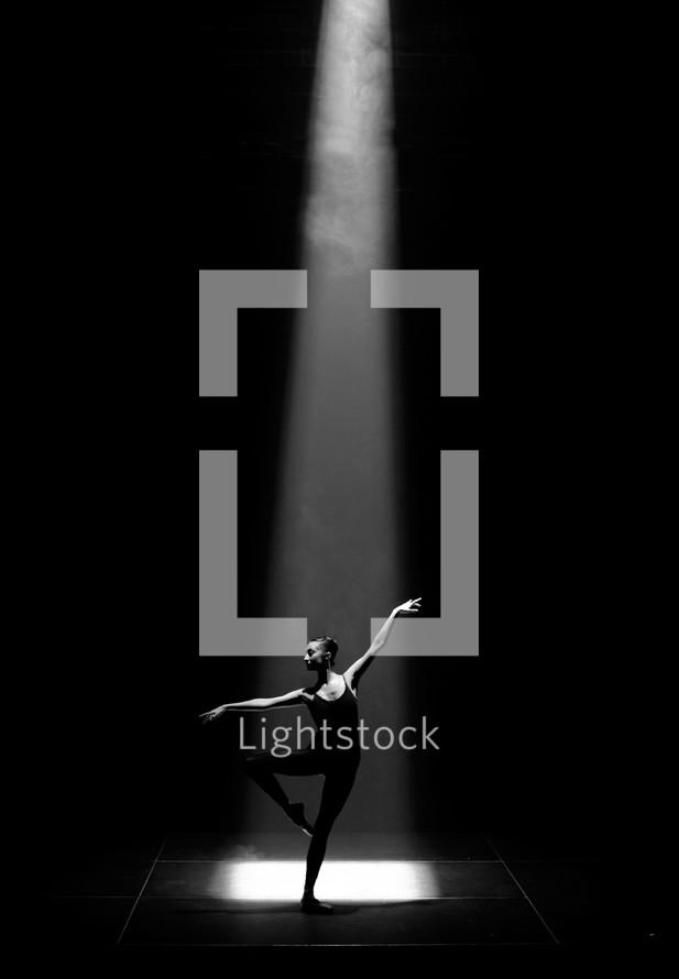 ballerina under a spot light