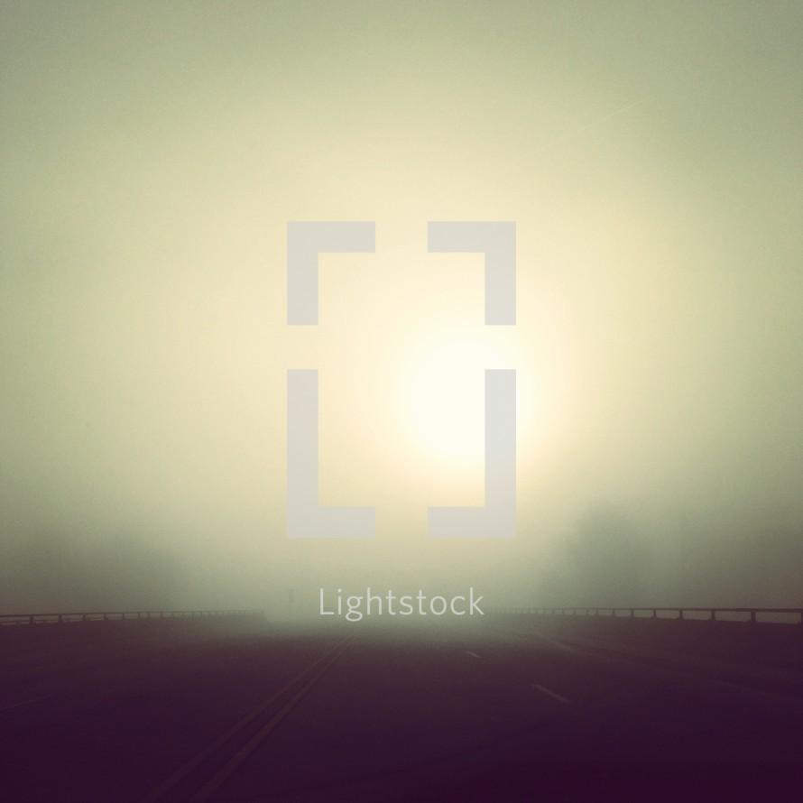 foggy sunrise over a highway