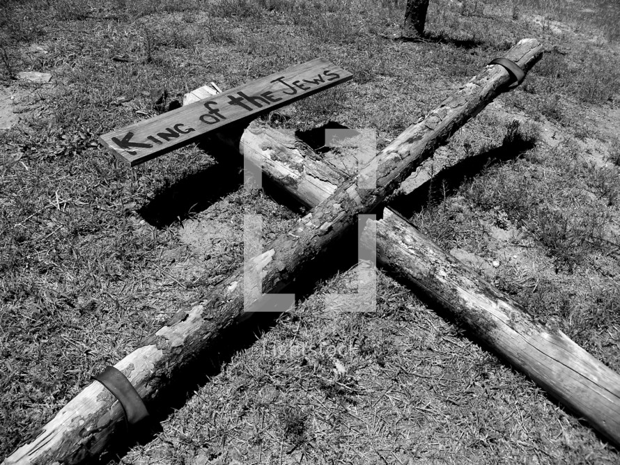 "The old rugged cross made of wood with the words ""King of the Jews"" that the romans included to mock Jesus as they crucified him on the cross at Golgotha, the place of the skull."