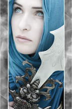 Queen of Narnia; woman in blue with blue eyes holding a sword.