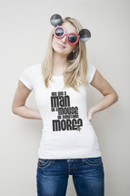 Man or a Mouse; woman with mouse glasses wearing jeans and shirt that reads 'Are you a man or a mouse or something more?'