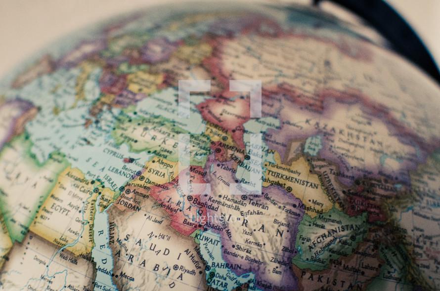 top of a globe