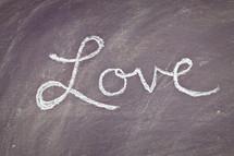 Love written on a chalkboard