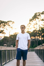 a young man in sunglasses