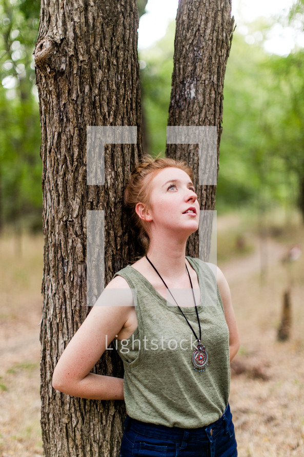 leaning against a tree, tree, woman, outdoors, posing, forest