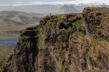 a man standing on a mountaintop in Iceland