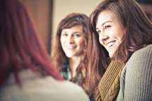 group of young women smiling at a Bible study