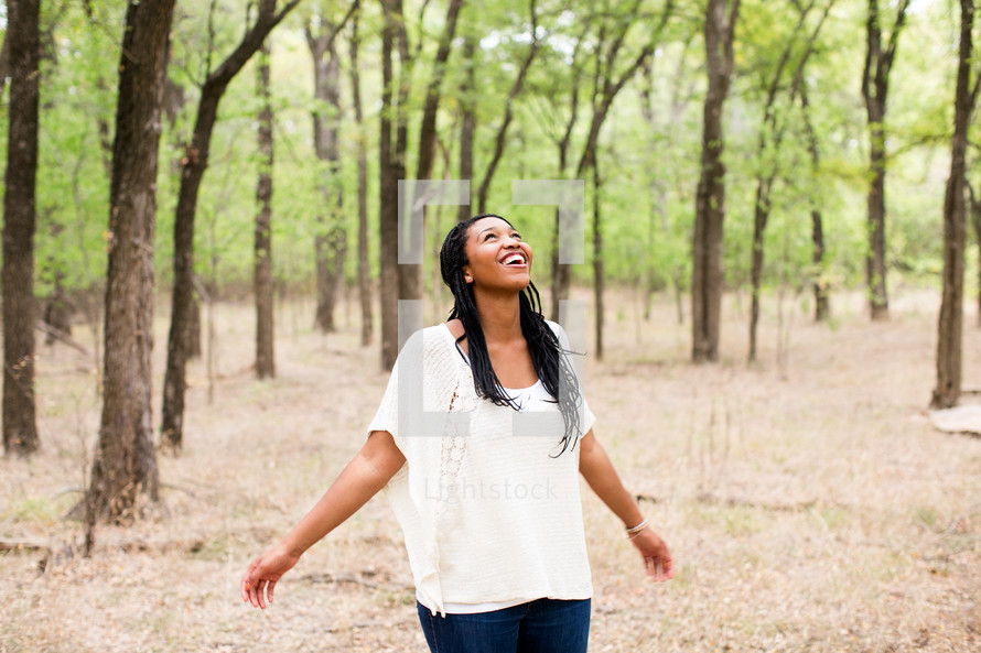 open arms, woman, standing, outdoors, rejoicing, joy, African American