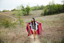 woman wrapped in a blanket outdoors