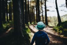 a boy walking along a path