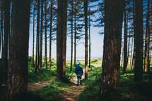 a boy walking through a forest