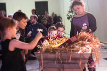 children playing flowers in a manger
