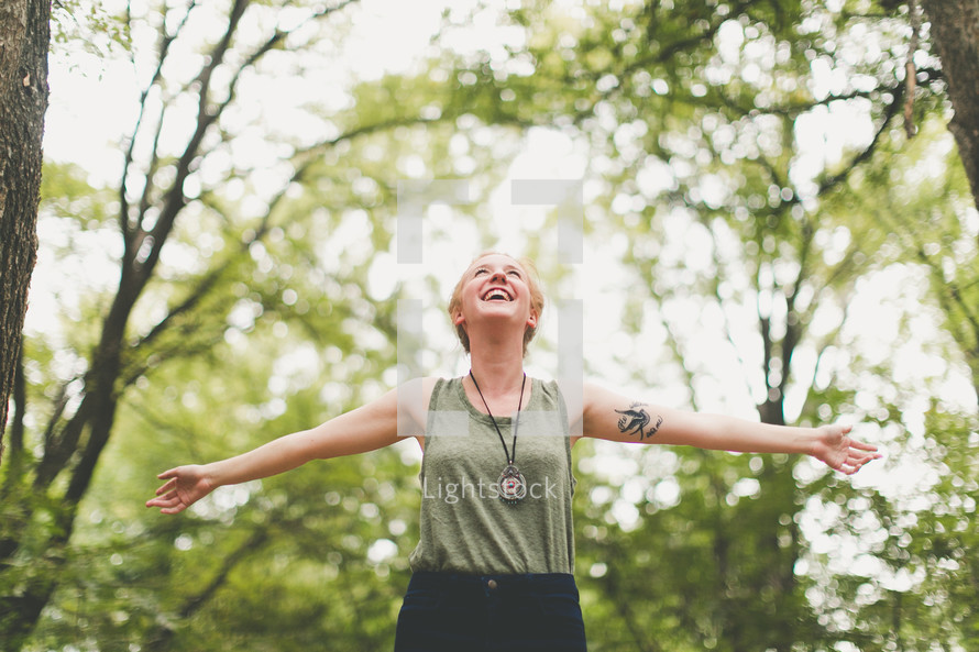 woman rejoicing outdoors